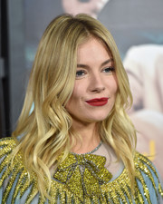 Sienna Miller topped off her look with a sexy red pout.
