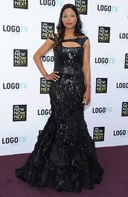 Aisha Tyler stunned on the red carpet when she chose this mermaid-style, ruffled gown with a beading and cutouts.