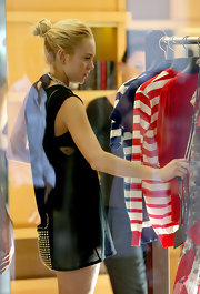 Lindsay Lohan ties her hair into a loose bun, while shopping in St Barts.