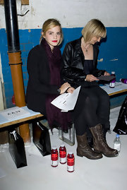 Emma looks tough-chic with lace-up combat boots for London Fashion Week.