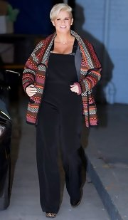 Kerry Katona spiced up an all black look with a multi-colored wool coat while in London.