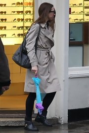 Mel C completed her wet London weather attire with a pair of flat boots.