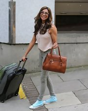Shobna Gulati wore this light pink sleeveless button down with a pair of skinny pants while out in London.