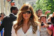 Jennifer Lopez causes a stir outside Le Royal Monceau hotel as she heads out to the Fun Radio studio wearing a short coat as a dress.