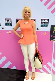 A pair of crisp white skinny pants balanced out Liz's structured peplum top.
