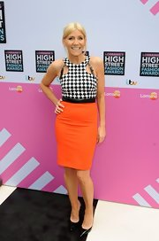 Michelle Collins opted for a cool bold print when she paired this black-and-white houndstooth top with an orange skirt.