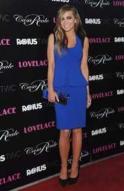 Carmen Electra sported an electric blue peplum dress with black leather edging on the sleeves.