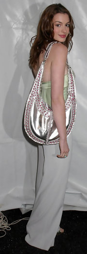 Anne wears a large metallic shoulder with her casual ensemble for the Luca Luca fashion show.