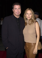 John Travolta's wife Kelly Preston sported a center part while attending the Lucky Numbers premiere.