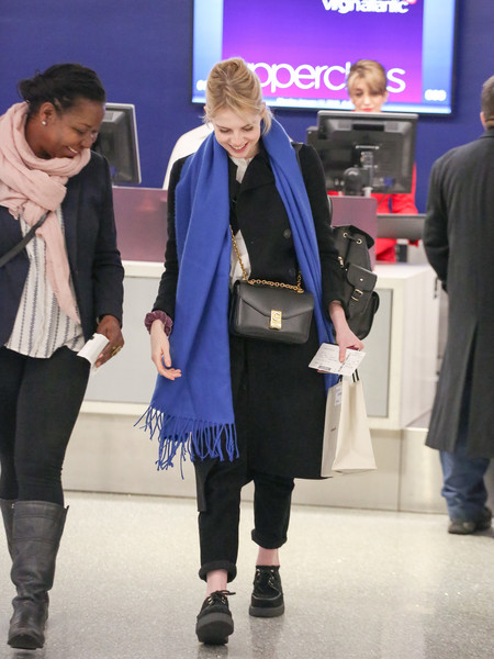 Lucy Boynton kept her feet comfy in a pair of black creepers.