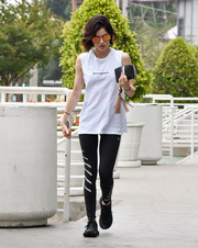 Lucy Hale sealed off her look with a pair of black Adidas Originals Tubular Entrap sneakers.