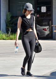 Lucy Hale looked ready for a workout in a black knot-waist tank top and matching leggings while out in LA.