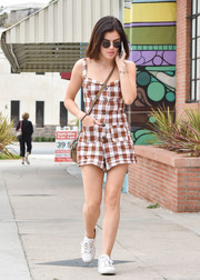 Lucy Hale completed her comfy ensemble with a pair of white leather sneakers by Koio.