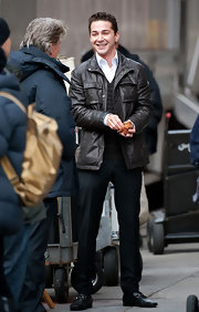 Shia LaBeouf kept warm with a handsome black leather jacket on the set of 'Wall Street 2.'
