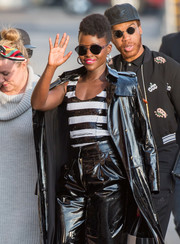 Lupita Nyong'o topped off her cool outfit with a pair of round shades.