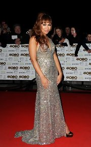 Rebecca Ferguson looked sparkly and sexy in a heavily beaded silver halter dress at the 2012 MOBO Awards.