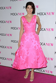 Marisa looks like a Barbie in this pink brocade 50's cut cocktail dress.