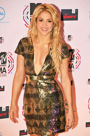 Shakira showed off her center part long waves while hitting the red carpet at the MTV Europe Music Awards. Her blond tresses were perfect for her sequined bronzed dress.