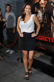 Lauren paired her black skirt with a mesh pair of platform sandals.