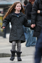 Mackenzie Foy's snow boots were a fuzzy and fashionable finish to her parka.