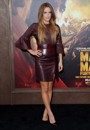 Riley Keough brought some edge to the 'Mad Max: Fury Road' premiere with this burgundy leather dress by Alexander McQueen.