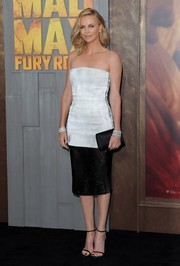 Charlize Theron went for sleek sophistication in a perforated, strapless black-and-white patent leather dress by Christian Dior at the 'Mad Max: Fury Road' premiere.