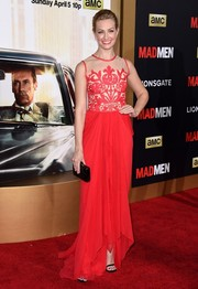 Beth Behrs paired her gown with a simple black box clutch.