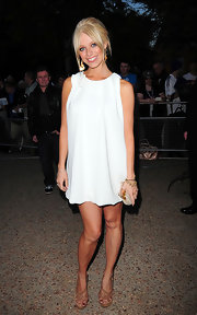 Liz Mcclarnon paired nude strappy sandals with her little white dress for a simple yet stylish finish.