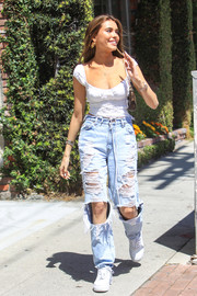Madison Beer was spotted out in Beverly Hills wearing a cute white lace-up top from Bamba Swim.