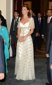Kate looked like a true queen in this gold-embroidered evening dress.