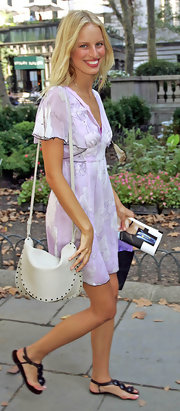 Karolina carries a white leather bag with her spring day dress for the Marc Jacobs fashion show.