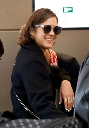 Marion Cotillard took a flight out of LAX wearing a stylish pair of aviators.