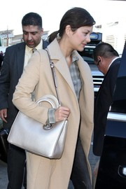 Marion Cotillard arrived at LAX carrying a stylish silver shoulder bag by Dior.