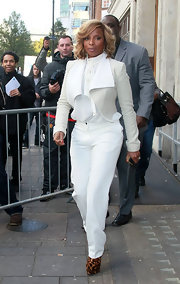 Mary J. Blige went for a monochromatic look at Radio One in pristine white pants, a tie neck blouse and a matching blazer.