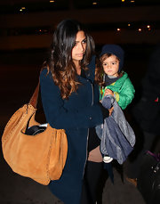 While carrying adorable son Levi, Camila toted around a tan suede shoulder bag. Her son is so cute we can hardly keep our eyes off him.