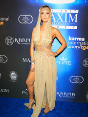 Joanna Krupa looked sizzling-hot dressed as Cleopatra in this beaded nude gown with a plunging neckline during Maxim's Halloween party.