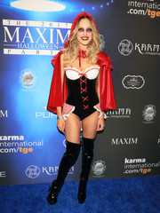 With her red cape, corseted bodysuit, and heavy eye makeup, Peta Murgatroyd looked both seductive and creepy as Little Red Riding Hood!