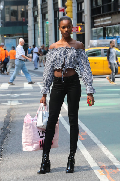 For her bags, Mayowa Nicholas chose a personalized pink shopper by Victoria's Secret along with a white a white leather purse.