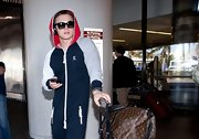 Jesse McCartney traveled in style with this this red, white, blue and gray zip-up hoodie.