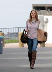 AnnaLynne McCord kept cozy on set in a sheer blush sweater accessorized with a blue beaded necklace.