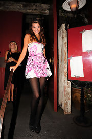 Rachel Mccord showed off her long legs in a strapless print mini dress during a night out with her sisters.