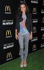 Jurnee Smollett mixed feminine with edgy when she paired this black leather jacket over a fun print blouse.
