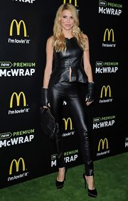 A leather peplum top gave Brandi Glanville a super-edgy, rocker-inspired look while at the McDonald's Premium McWrap Launch party.