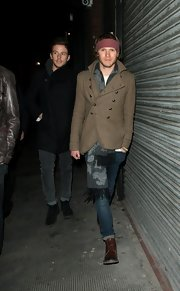 Dougie Poynter chose a double-breasted pea coat for his casual look for a night out in London.