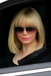 Rose McGowan swapped her long chocolate-colored tresses for this super-modern blond blunt-cut banged 'do.
