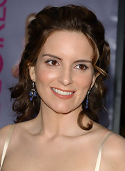 Tina Fey adds a touch of blue with these gemstone earrings.