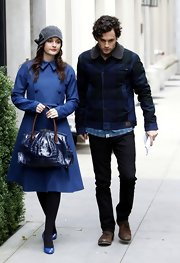 Leighton Meester punctuated her royal blue coat with a navy crocodile bag with brown lizard handles.