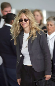 Meg Ryan traveled through JFK airport in a grey blazer and her favorite pair of square shades.