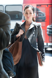 Megan Fox sported a gray bold-shouldered coat with tonal stripes at LAX.