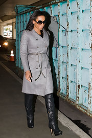 Spice girl Melanie Brown showed off these knee high black leather boots, while out and about with her husband at LAX airport. Her grey trench coat was the perfect length for these killer boots.